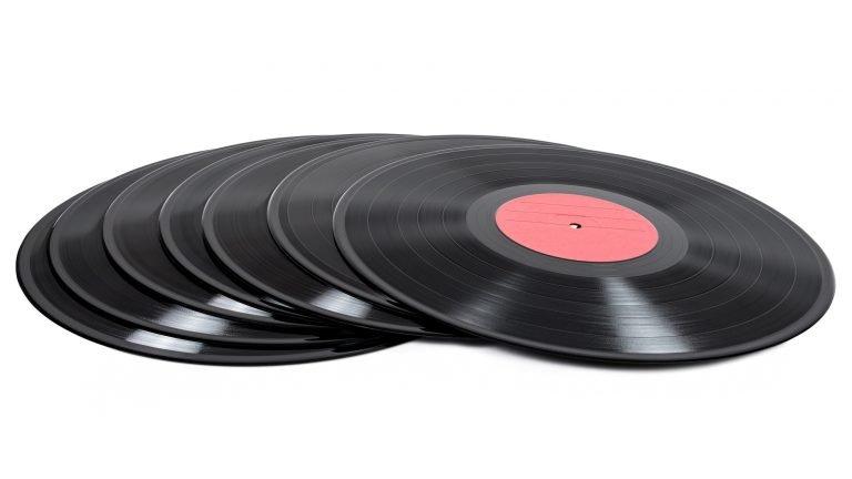 Stack of vinyl records on white background