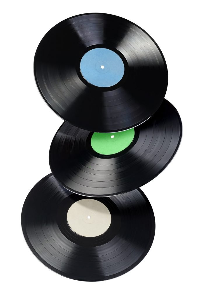 Three 12-inch vinyl records with blank label isolated.