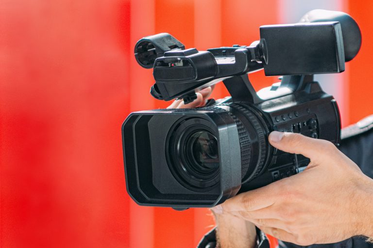 Videographer Recording Event