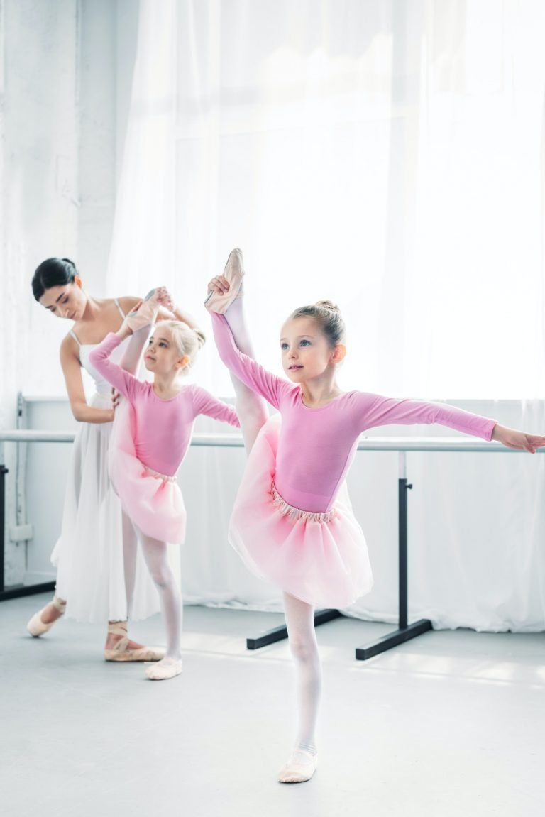 ballet teacher exercising with small dancers in ballet school home movie
